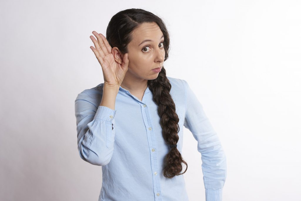 About Hearing Loss. Single-Sided Deafness with woman holding hand behind her right ear