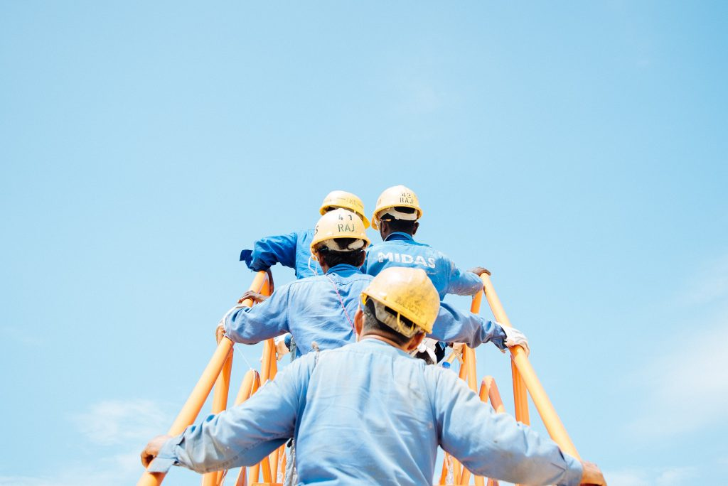 workers going up the stairs. Workers Compensation Guide